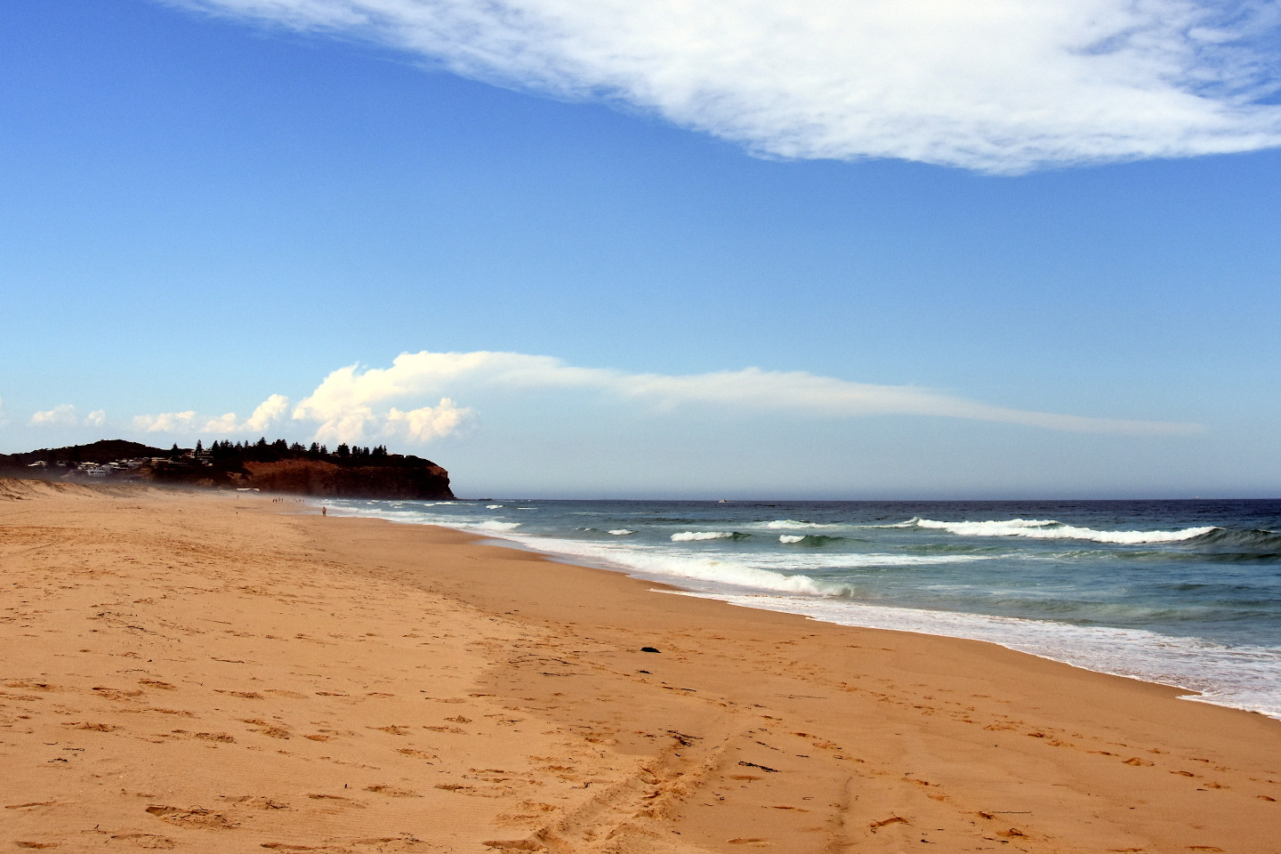 Belmont Nine Miles beach on a cloudy day in summertime. Redhead Point in the background (Newcastle, NSW, Australia).