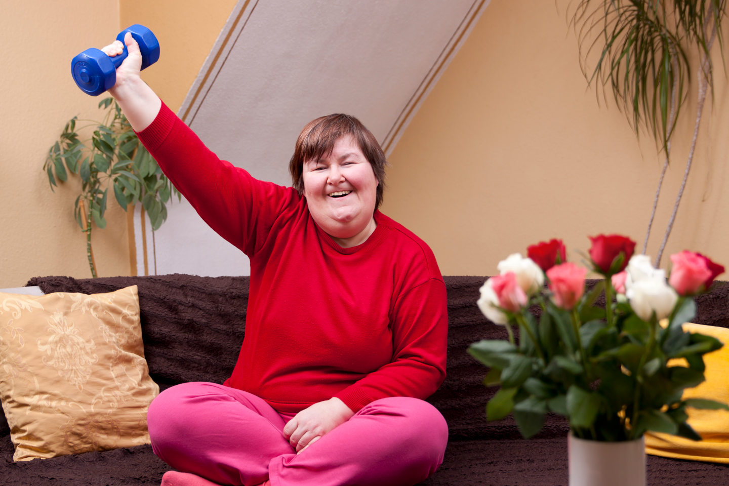 Mentally disabled woman shows her strength with a dumbbell