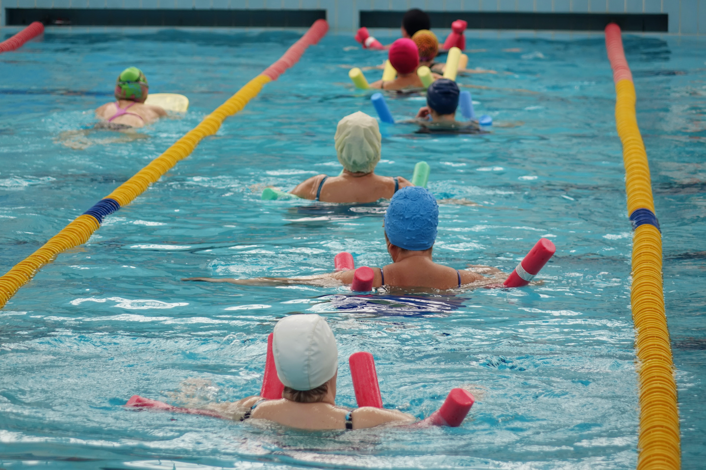 group of older adult swimmers meeting at valentine pool for a hydrotherapy rehabilitation class